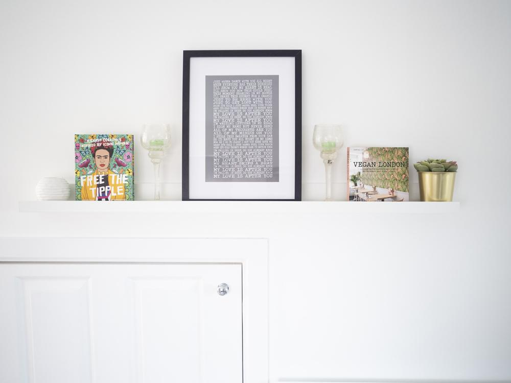 Picture rail above a white understairs cupboard