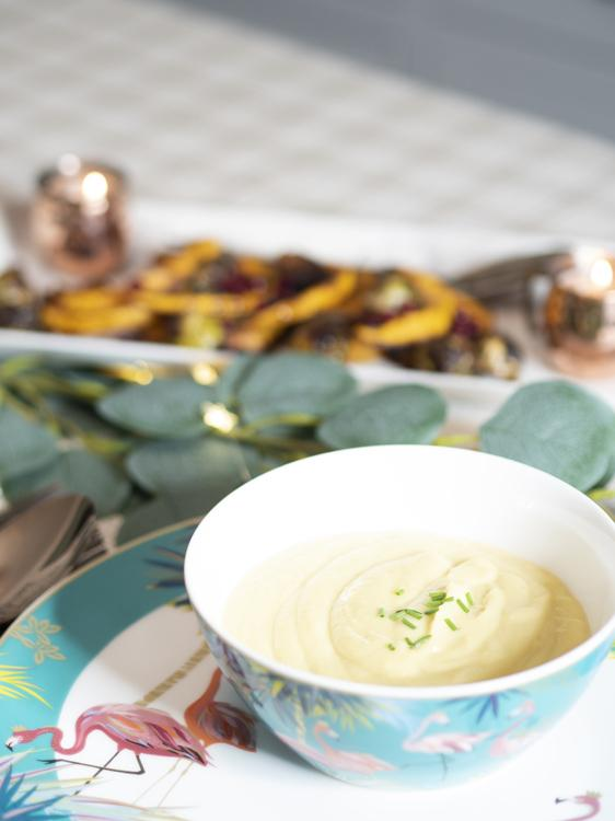 Festive leek soup in a pretty decorated dinnerware bowl from Sarah Miller London featuring flamingos