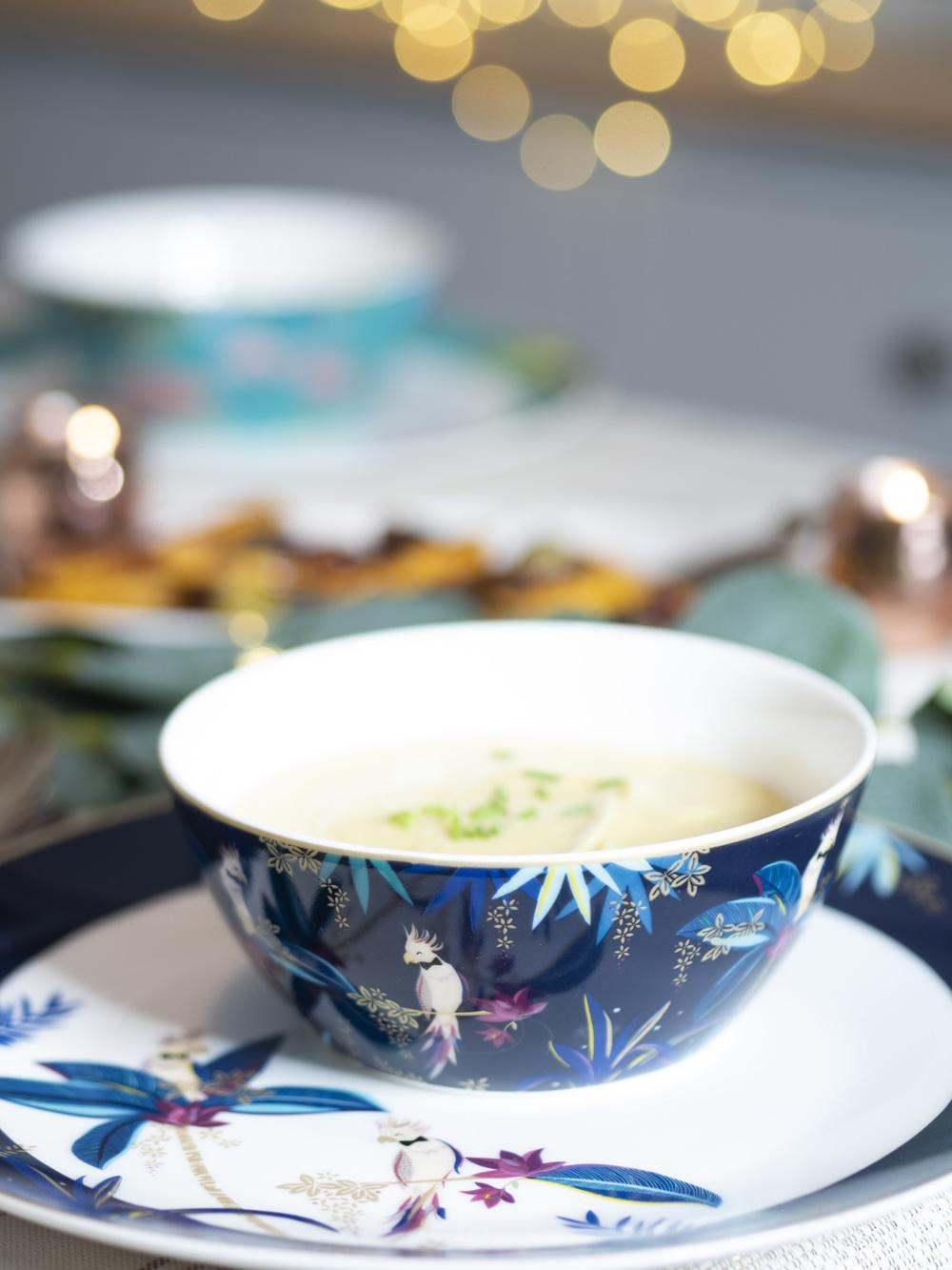 Festive leek soup in a pretty decorated dinnerware bowl from Sarah Miller London featuring cockatoos
